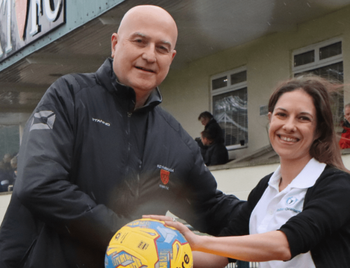 Miranda Redfern from Redferns sponsors the match ball against Bitton
